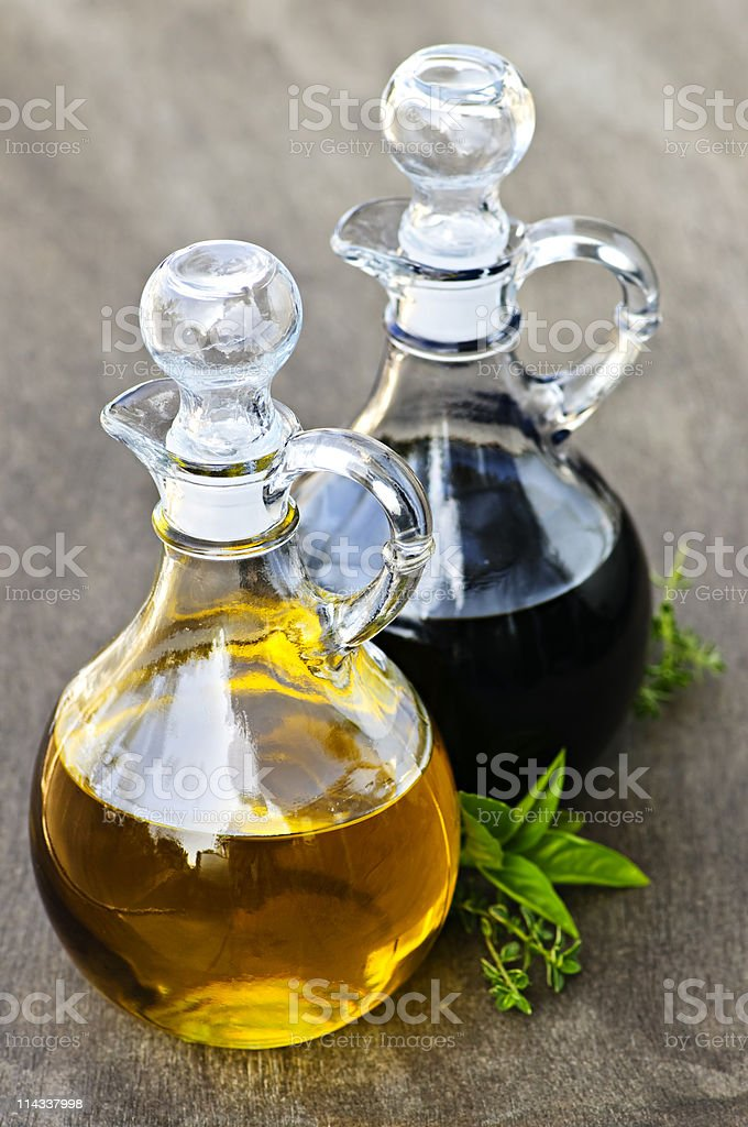 Bottles of oil and vinegar on wooden table stock photo