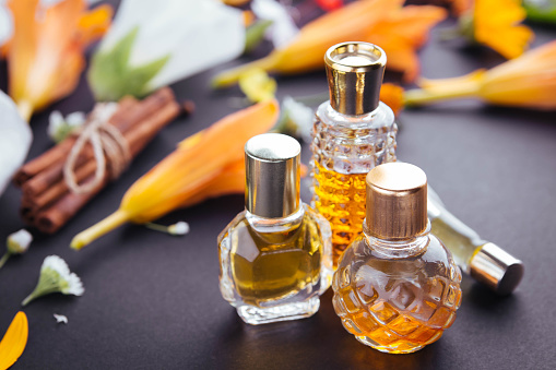 istock Bottles of perfume with ingredients 814013994