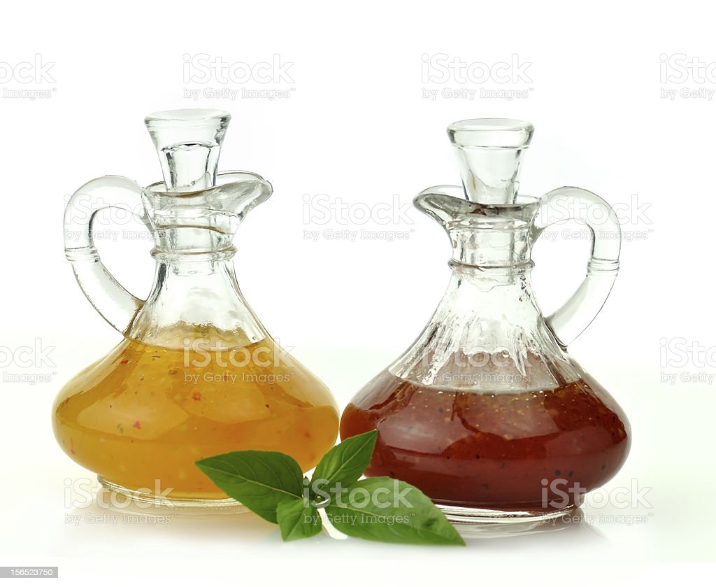 Bottles of salad dressing over a white background stock photo