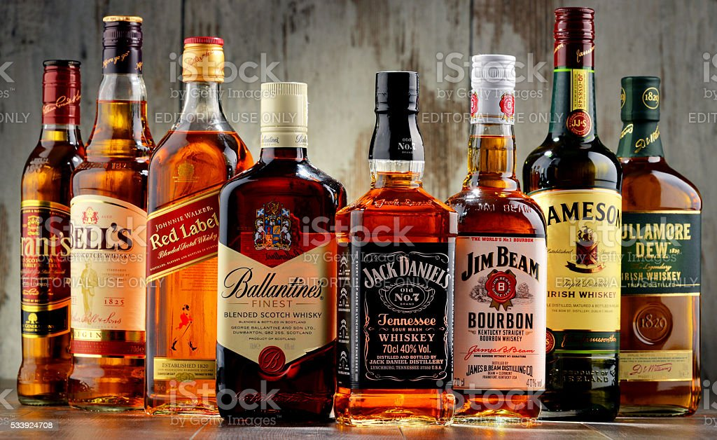 Bottles of several whiskey brands from USA, Ireland and Scotland stock photo