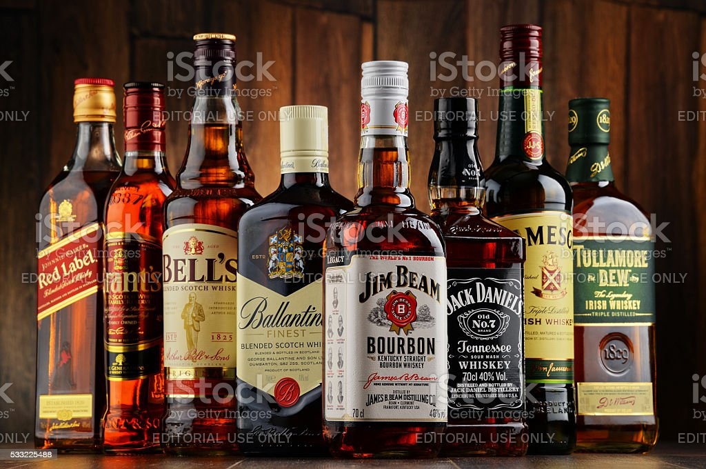 Bottles of several whiskey brands from USA, Irland and Scotland stock photo