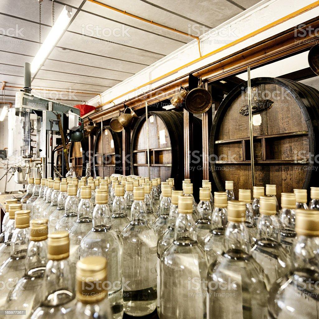 Bottles of vodka and whisky barrels stock photo