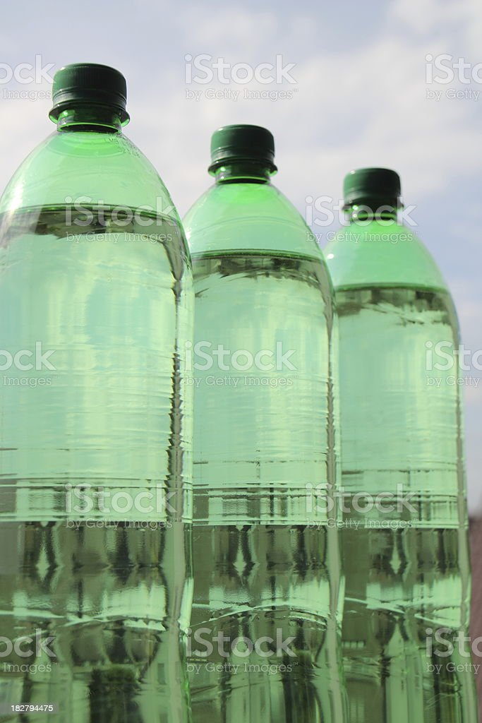 bottles of water in green royalty-free stock photo