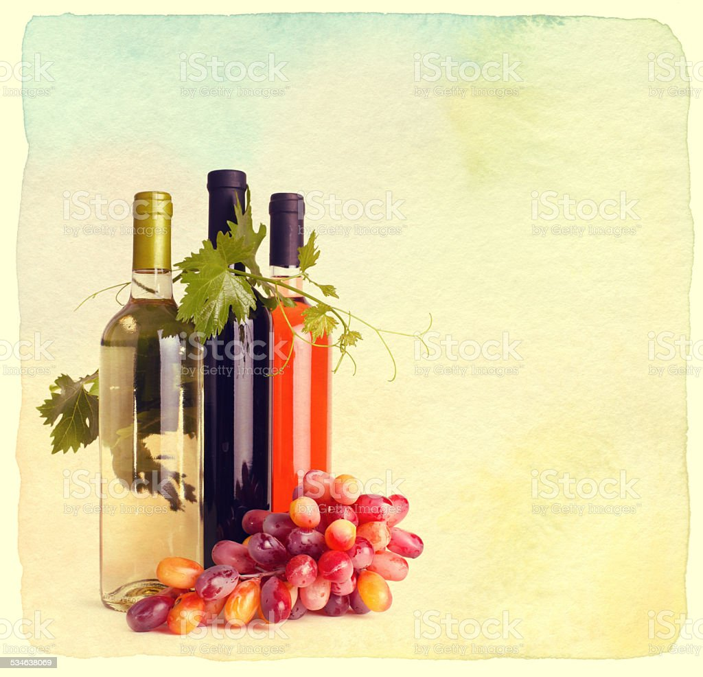 Bottles of wine and grapes stock photo