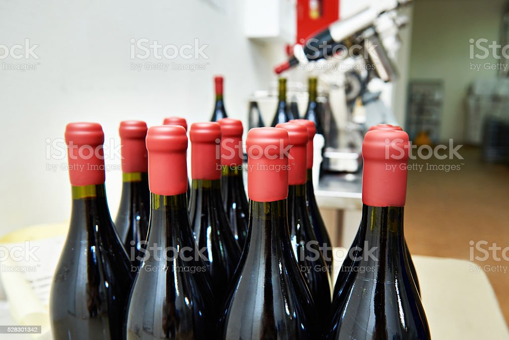Bottles of wine in factory after sealing stock photo