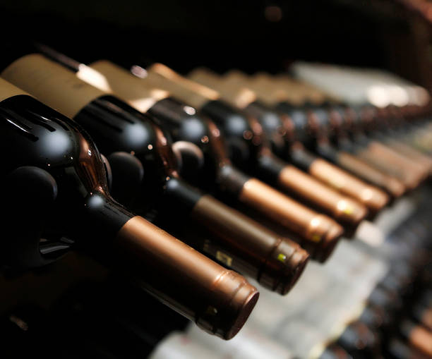bottles of wine in row bottles of wine in row cellar stock pictures, royalty-free photos & images