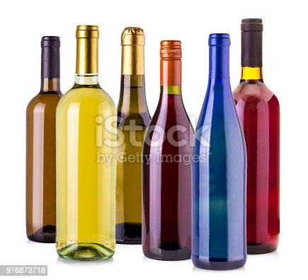 istock bottles of wine  isolated on white background. 916873718