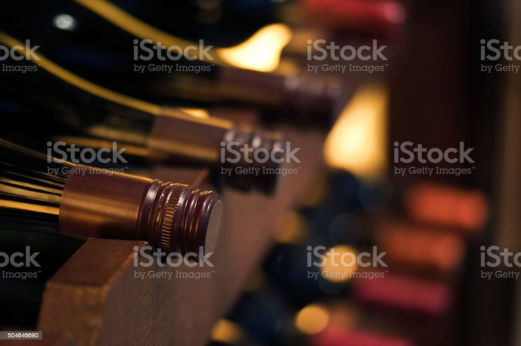 Bottles of wine on a shelve stock photo