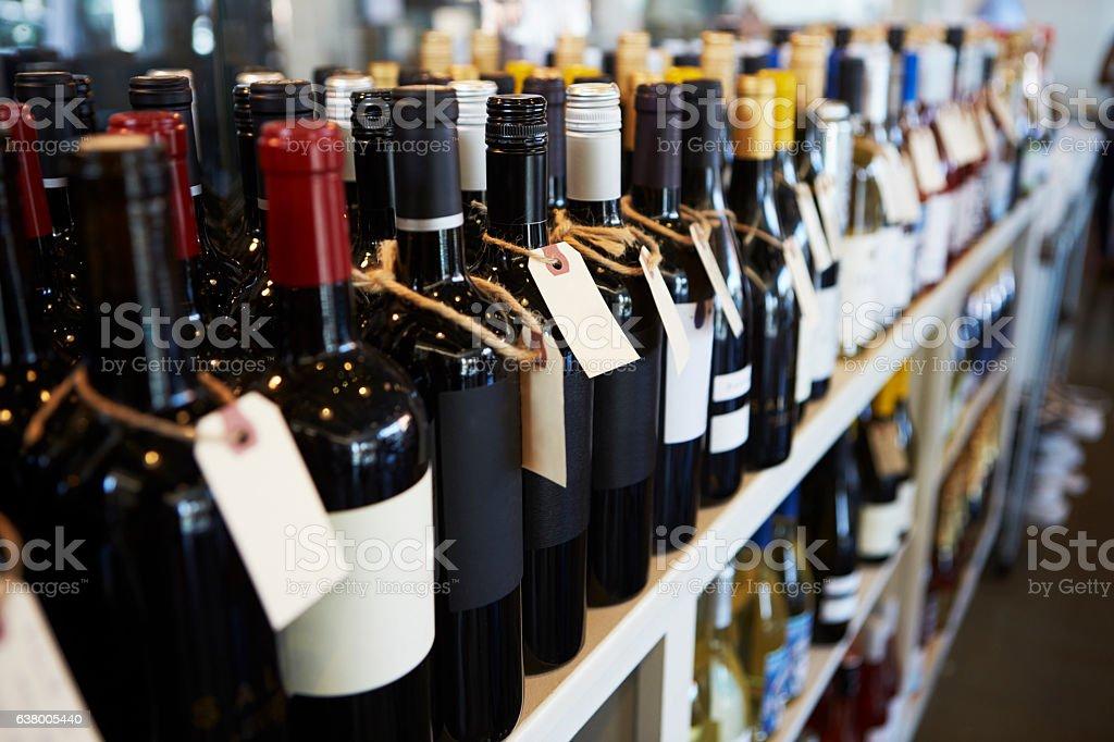 Bottles Of Wine On Display In Delicatessen stock photo