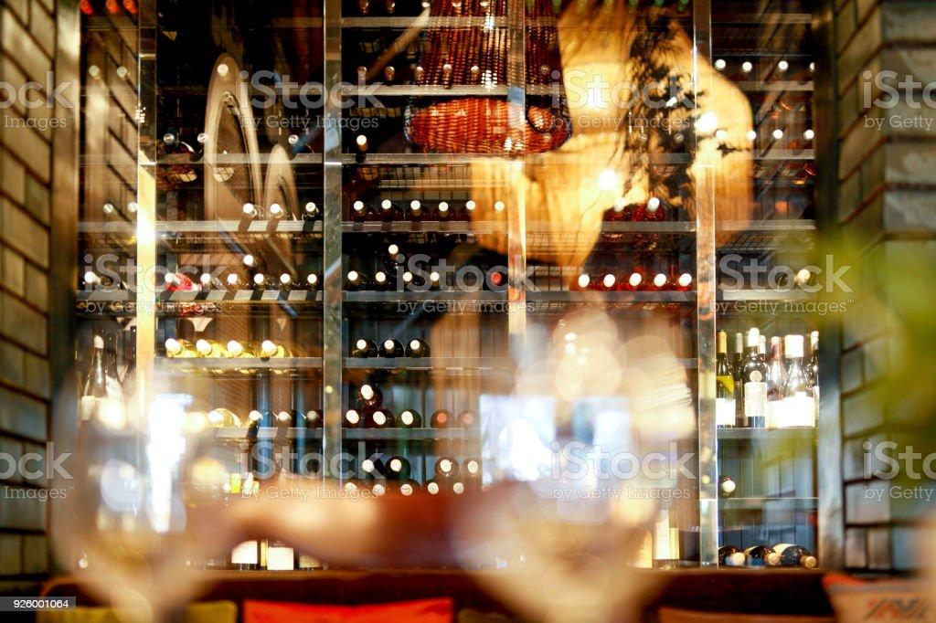 Bottles of wine on shelf in restaurant stock photo