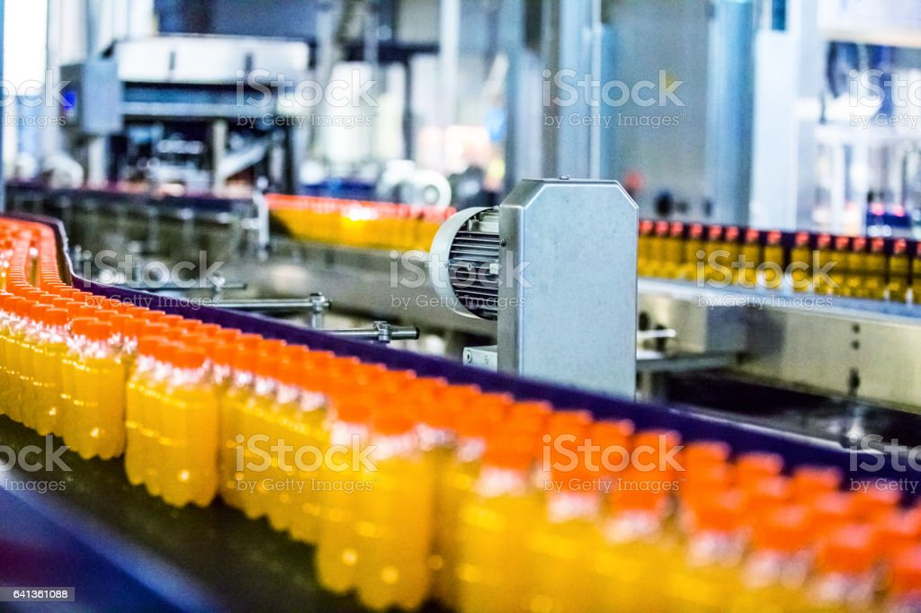 Bottles on Conveyor Belt in Factory stock photo