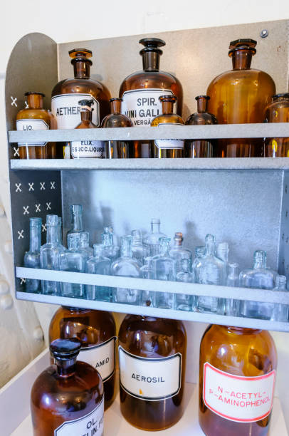 Bottles on shelves within a doctor's surgery from WW1. Bottles on shelves within a doctor's surgery from WW1. 1910 1919 stock pictures, royalty-free photos & images
