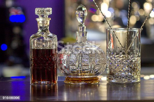 1013514594 istock photo Bottles on the bar, bar interior 916486996