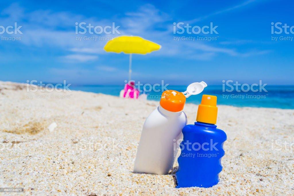bottles on the sand stock photo