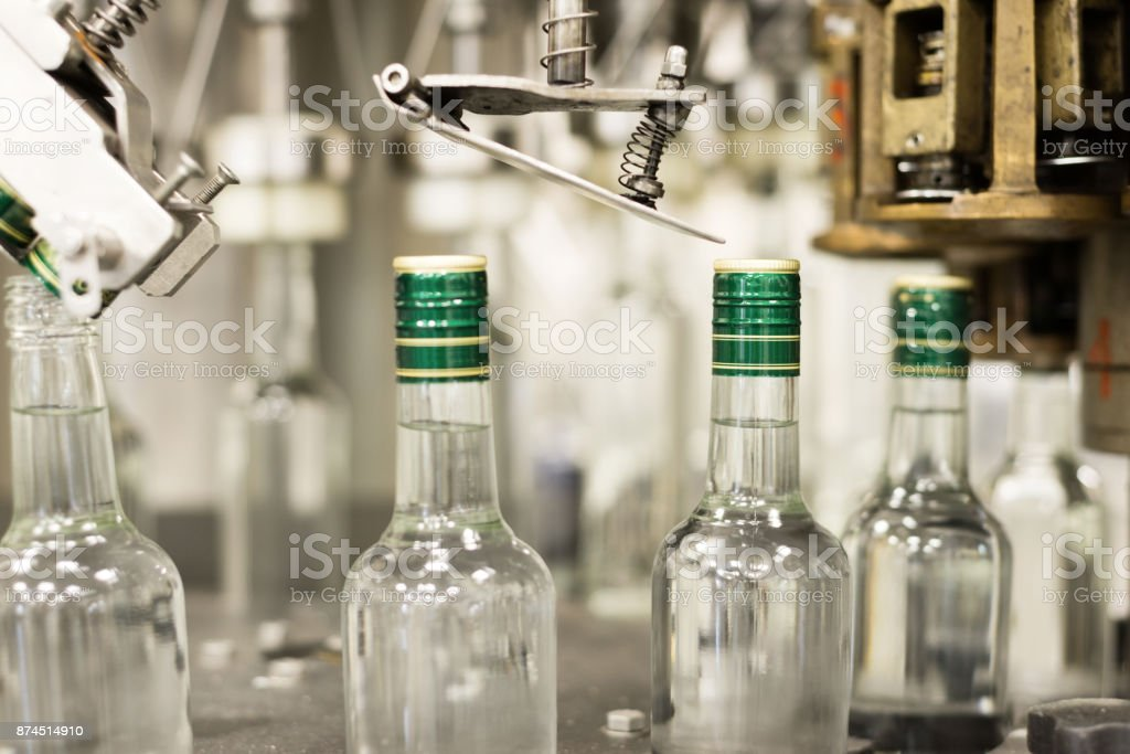 Bottles with a drink closed with a screw cap stock photo