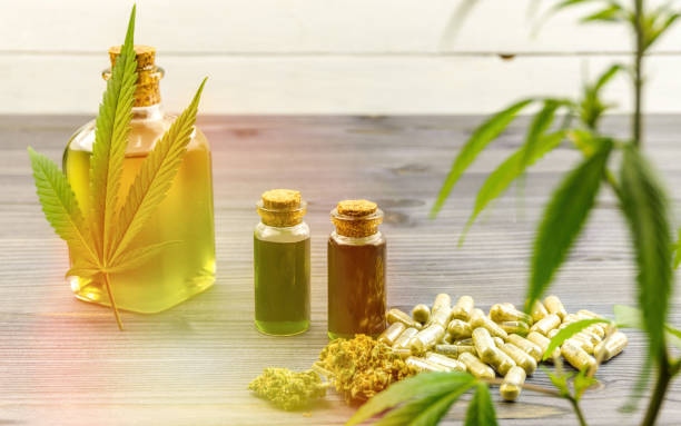 Bottles with Cannabis CBD oils, flower buds and pills with hemp plant stock photo