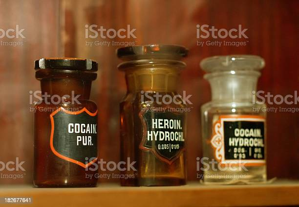Bottles With Cocaine Heroine In An Old Pharmacy Stock Photo - Download Image Now