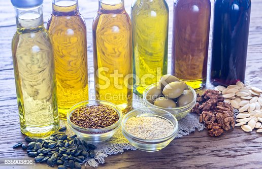 istock Bottles with different kinds of vegetable oil 635903896