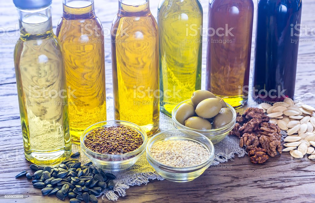 Bottles with different kinds of vegetable oil - foto de stock