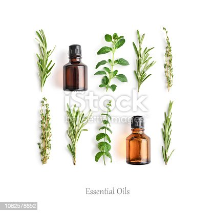 istock Bottles with essential oils and fresh herbs 1082578652
