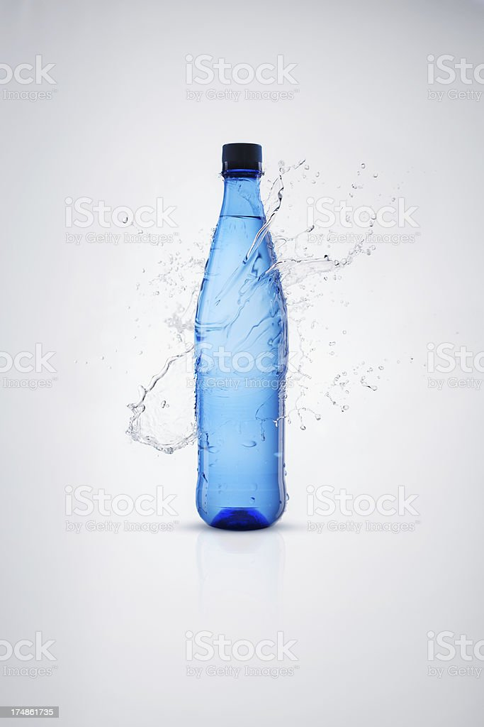 Bottles with mineral water and splash around it royalty-free stock photo