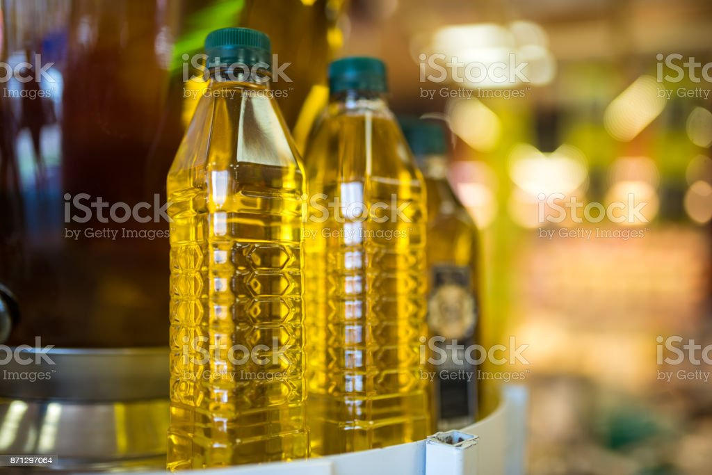 Bottles with olive oil in the market stock photo