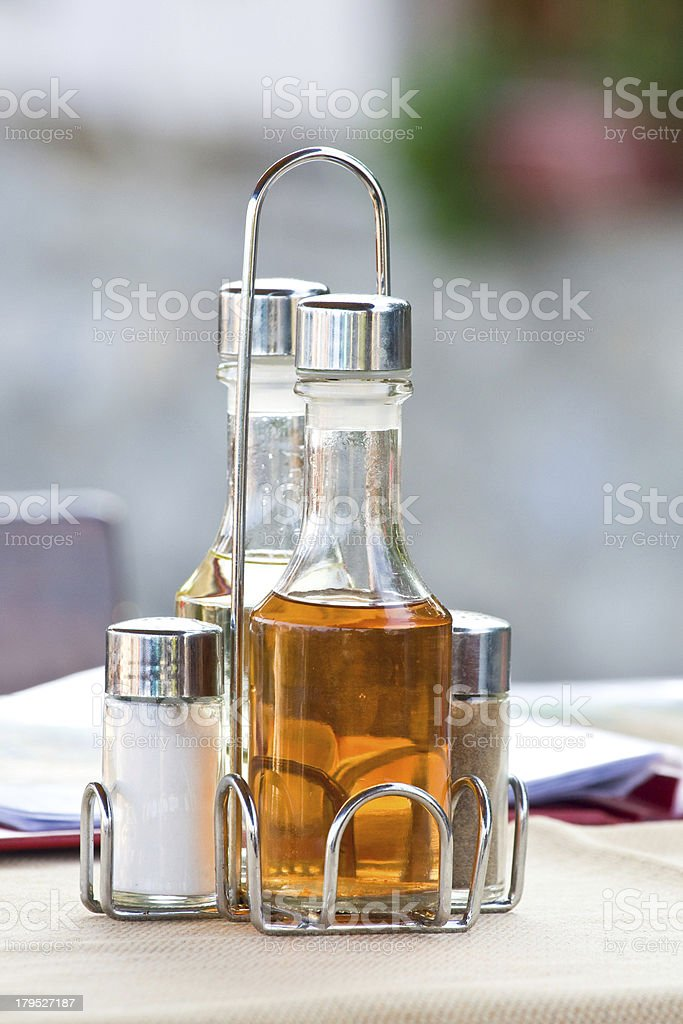 Bottles with olive oil, vinegar on the table in restaurant royalty-free stock photo