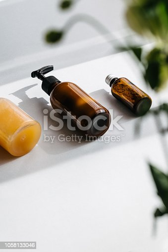 824824368 istock photo Bottles with organic cosmetics overhead 1058133046