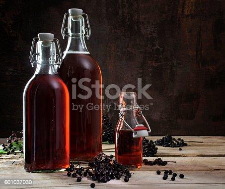 istock bottles with red juice of black elderberries (Sambucus nigra) an 601037030