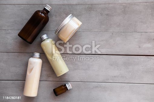 istock Bottles with spa cosmetic products flat lay 1184260181