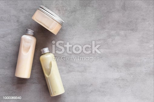 istock Bottles with spa cosmetic products flatlay 1000089340