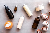 istock Bottles with spa cosmetic products flatlay 981159480