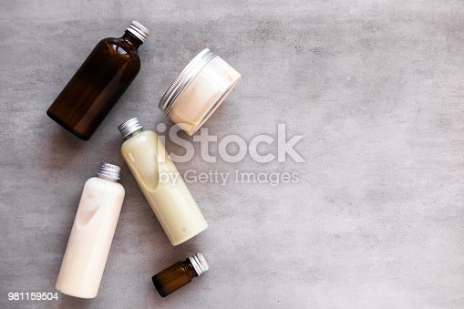 1167558793 istock photo Bottles with spa cosmetic products flatlay 981159504