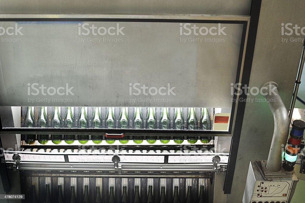 Bottle-washing machine for wine-making royalty-free stock photo