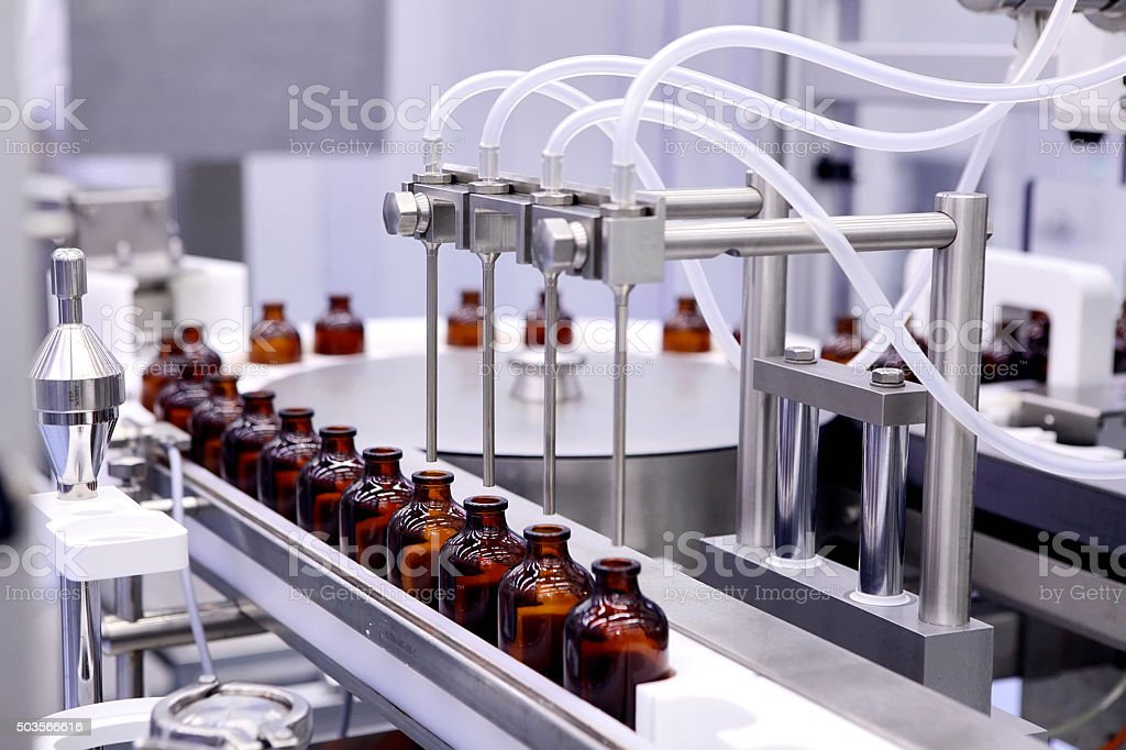 Bottling and packaging of sterile medical products. Machine afte stock photo