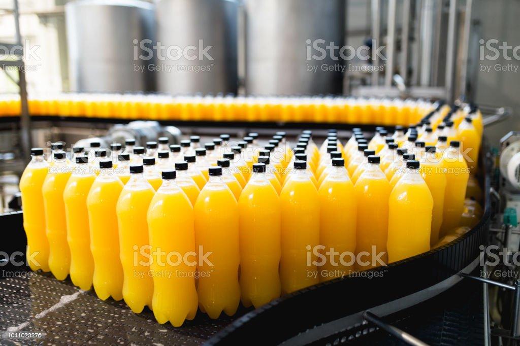 Bottling factory - Orange juice bottling line for processing and...
