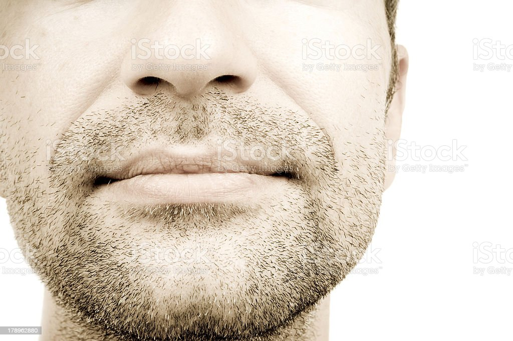 Bottom half of a man's face with stubble stock photo