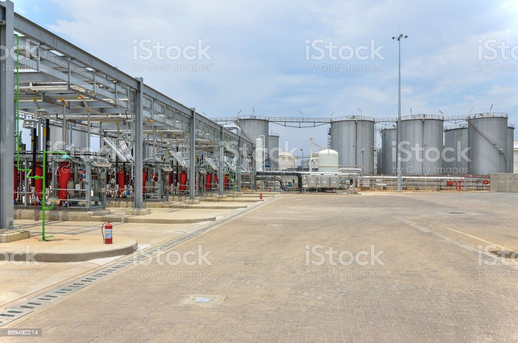 Bottom loading tank trucks terminal with tank farms stock photo