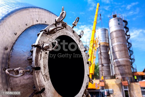 Bottom of disassembled obsolete massive old metal silos waiting for cassation.