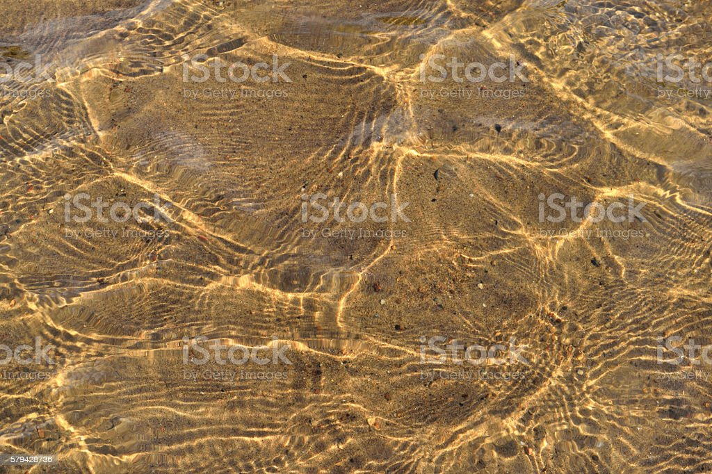 bottom of the river with sand background stock photo