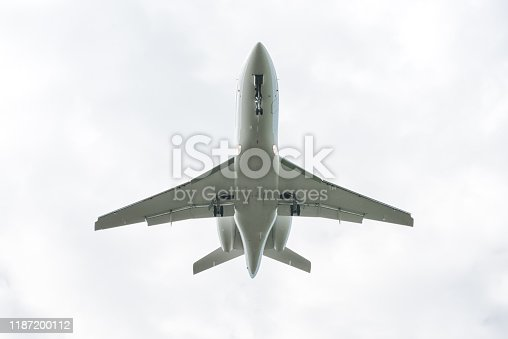 bottom view of an airplane during landing approach