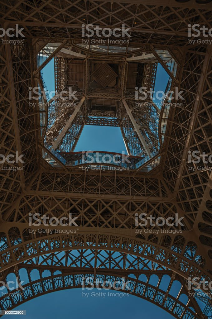 bottom view of eiffel tower made in iron and art nouveau style with