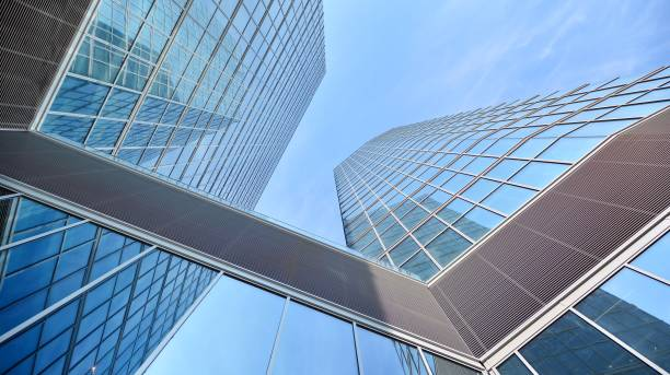 Bottom view of glass silhouette of skyscraper. Business building. Skyscraper with glass facade. stock photo