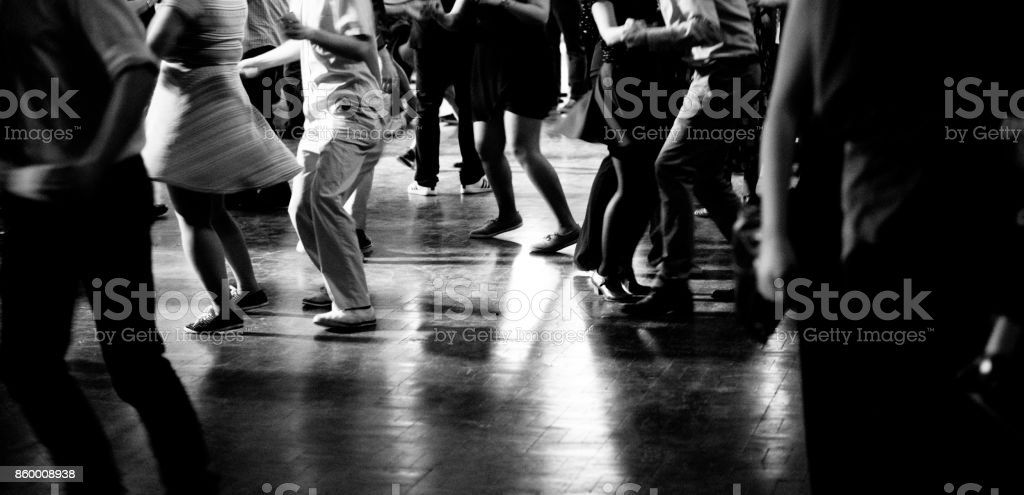 Bottom view of People legs dancing in black and white stock photo