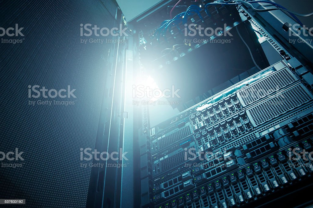 Bottom view of rack server against neon light in datacenter stock photo