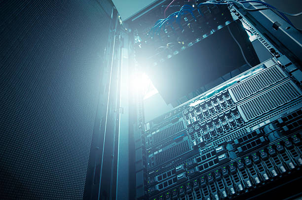 Bottom view of rack server against neon light in datacenter stock photo