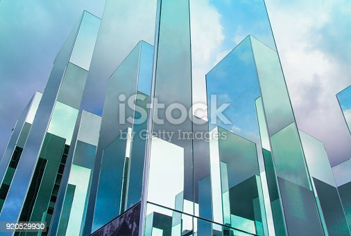 istock Bottom view of reflection of blue sky on building mirror. Abstract background. 920529930