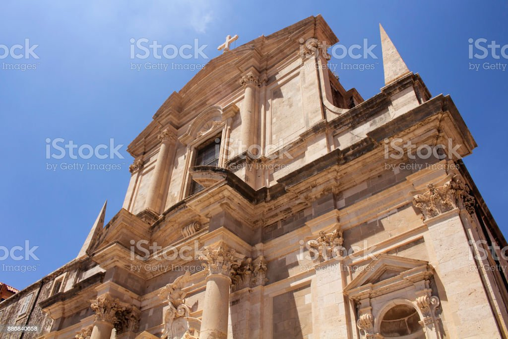 Bottom view of Saint Ignatius Church in Dubrovnik old town with clear blue sky background. stock photo