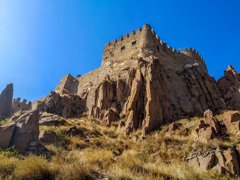 Bottom view of the rocky cliffs at the bottom of the tower of Ankara Castle (Turkey)