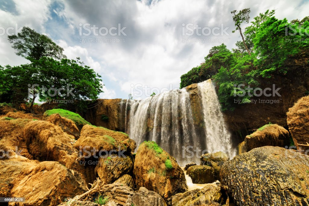 Bottom view of waterfall among green woods. Summer landscape foto stock royalty-free